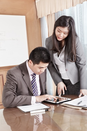 Two business people working together in the office Stock Photo - 12751241