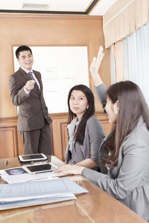Businessman doing presentation in the office photo