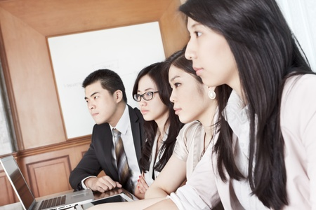 focus group: Group of Asian business people listening in a meeting season