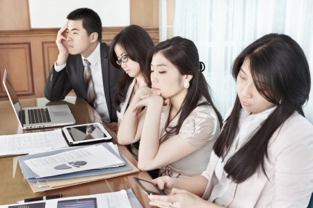 Group of business people look bored during meeting Stock Photo