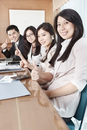 Group of business people looking to the camera photo