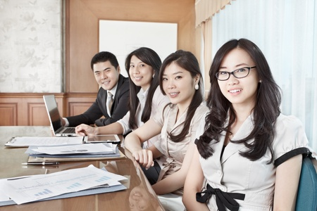 asian success: Group of business people looking to the camera