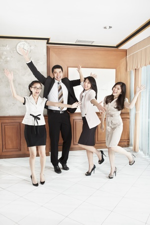 Group of business people expressing their excitement in the office photo