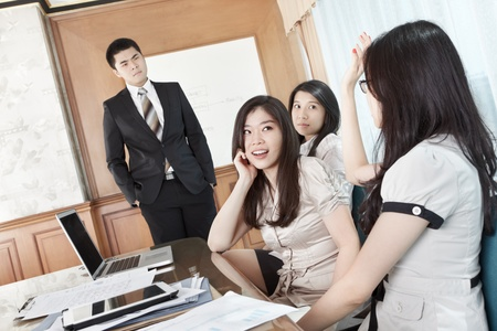 briefing: Businesswoman raise hand to ask the manager in a briefing