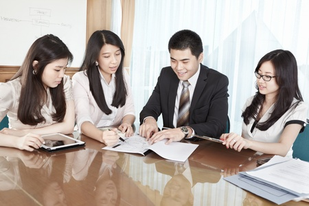 Group of business people discussing something in the office photo