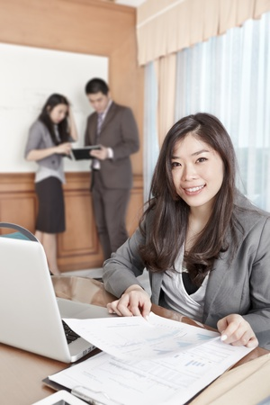 asian business women: Chinese businesswoman smiling to the camera in the office