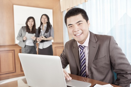 Chinese businessman working in office photo