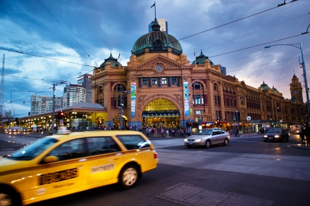 flinders: Melbourne, Australia - April 6th, 2012 : The Flinders station in the afternoon and the  traffic around it Editorial