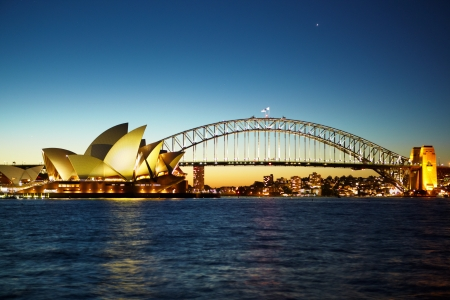 Sydney, Australia - April 13th, 2012 : Sydney opera house and Sydney Harbour bridge taken at nite. if you watch carefully,there is star constelation above the bridge