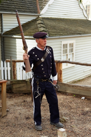 ballarat: Melbourne VIC, Australia - April 26th, 2012 : The old time police officer in Ballarat with the rifle