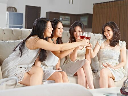 Four young women toast and celebrating their meeting photo
