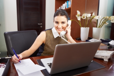 young woman working in the office alone photo