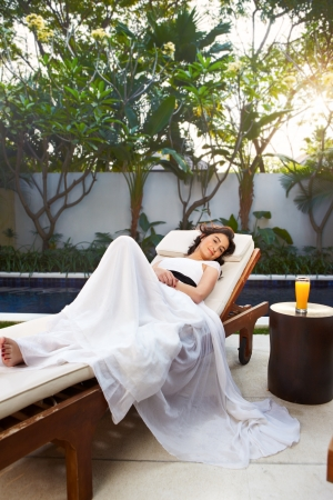 young woman relax in the afternoon at Balinese villa Stock Photo - 17335295