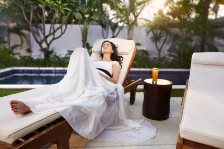 young woman relax in the afternoon at Balinese villa