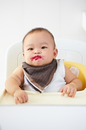 baby eating: Baby girl after being eating loking at camera