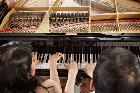 Two people, a couple playing piano duet, showing mostly their hands Standard-Bild