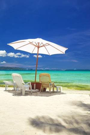 rest day: Relax area on beach with umbrella to shade from sunlight. Great for summer vacation background