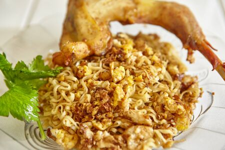 scramble: Instant fried noodle with scramble egg and fried chicken