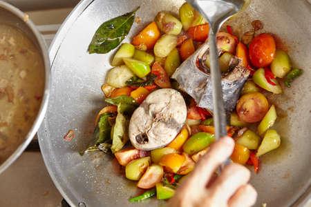 bilimbi: Stir frying the spicy tuna on the cooking wok