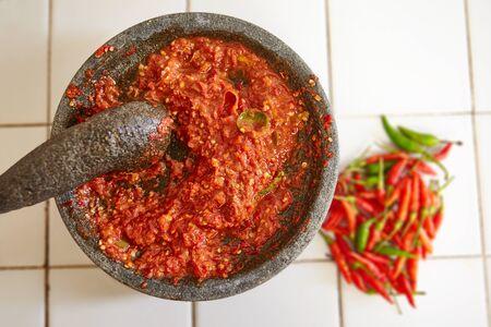 pebles: Sambal and its main ingredients, chili Stock Photo