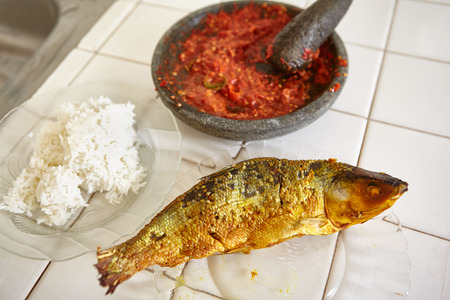 pebles: Sambal for sidedish with steamed rice and fried fish Stock Photo