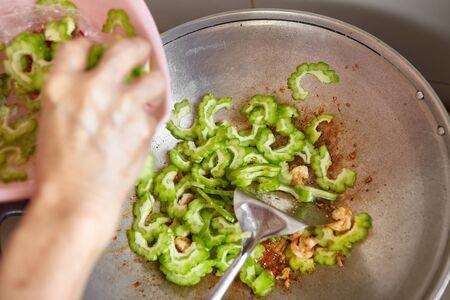 stir fry: Stir fry the bitter melon on the wok