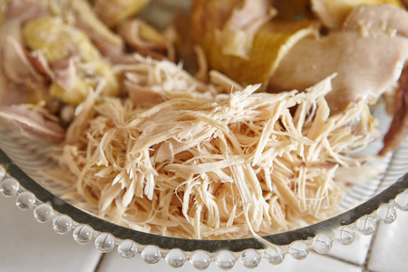 Shredded chicken for the ingredient for Soto, the traditional Indonesian chicken soup Standard-Bild