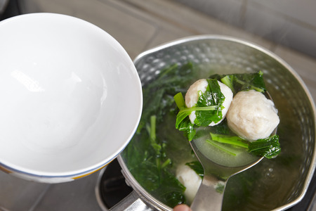 fish ball: Making fish ball soup with green vegetable Stock Photo