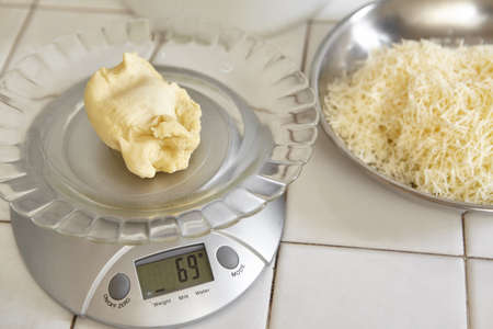 kitchen scale: Weighing bread dough using electronic scales