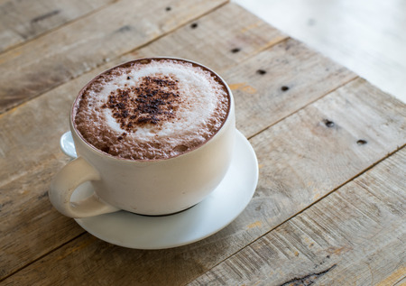 cup of hot cofee on wooden table photo