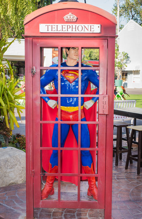 superman in the telephone box at the shopping park