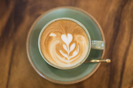Cup of coffee on a wooden background ,topview photo