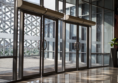 windows and doors: glass door of the office building. Stock Photo