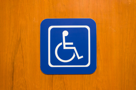 bule disabled person sign on wood wall photo