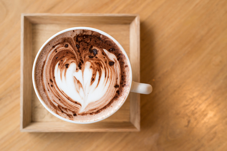 Cup of coffee on a wooden table photo