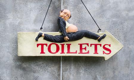 Vintage-Retro Toilet sign on concrete background photo