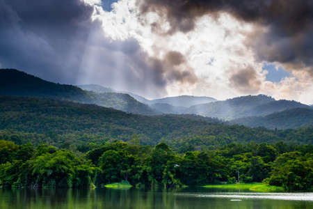 wonderful clouds over mountains and lake photo