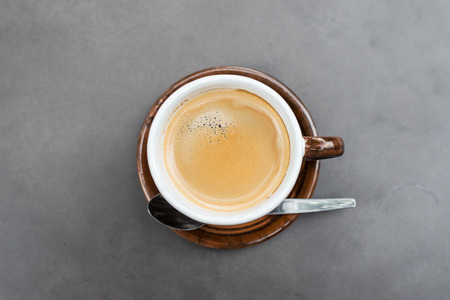 Cup of coffee on  metal color background photo