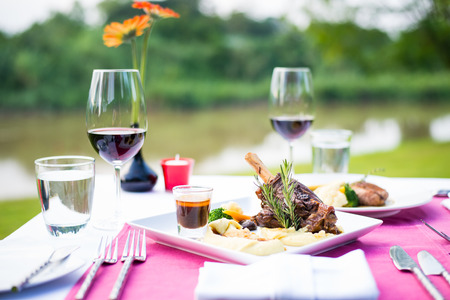 shank: lamb shank and red wine outdoor restaurant table setting