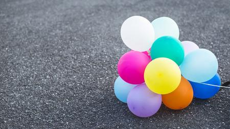 noisemaker: multicolored balloons on street ground