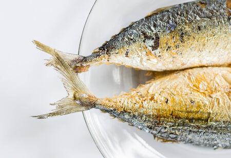 tail of fried Mackerel fish on dish photo