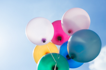 multicolored balloons on blue sky background Imagens