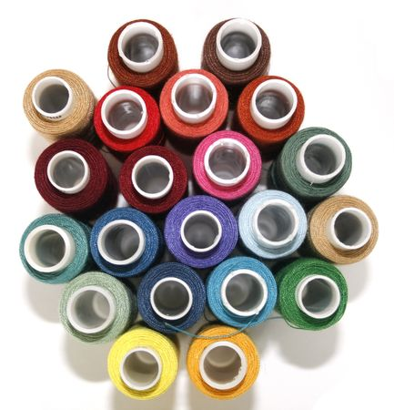 Background of the coils with different colored threads.