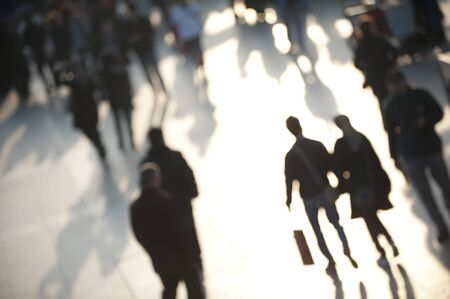 Blur image of crowd in bright sunlight, with shopping couple holding hands Stock Photo - 9249464