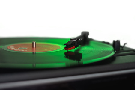 Old turntable green lit on white background Archivio Fotografico