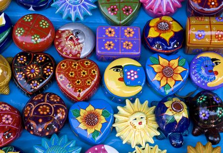 Assortment of colorful, hand-painted Mexican clay objects Stock Photo