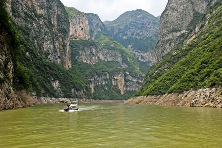Excursion boat travelling upstream in the Three Gorges  Yangtze area in Central China