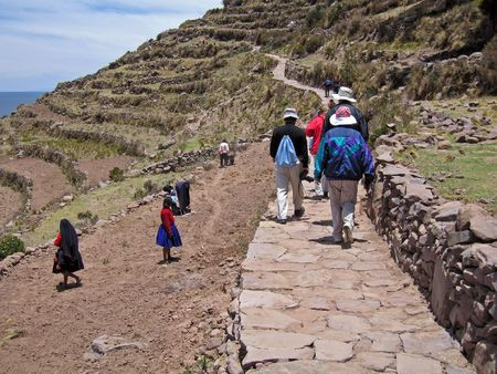 terracing: Hiking trail on the island of Taquile on lake Titicaca in Peru Stock Photo