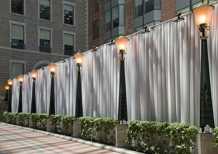 Curtained dividing wall in a commercial complex with light poles