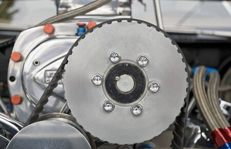 supercharger: Drive pulley on an automotive supercharger with toothed belt